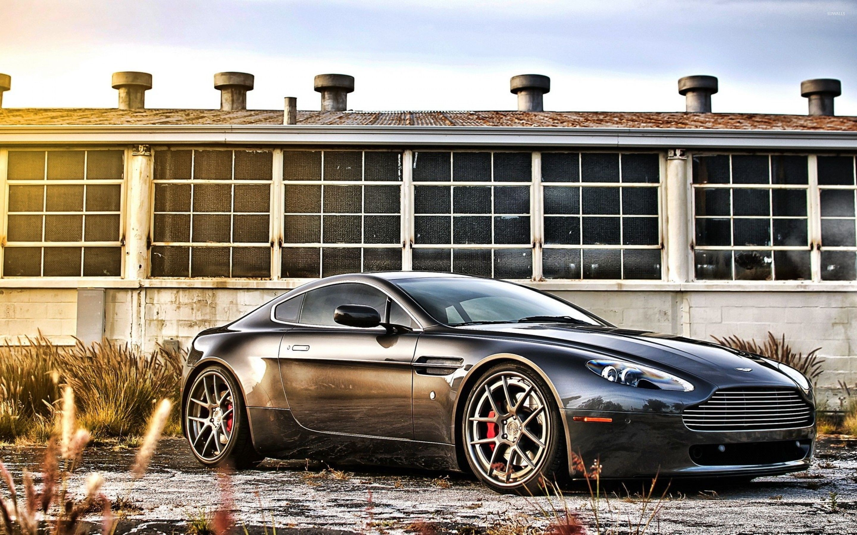 синий автомобиль Aston Martin  № 2593883 бесплатно