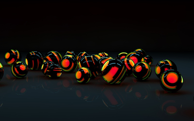 Black shells protecting the orange orbs wallpaper
