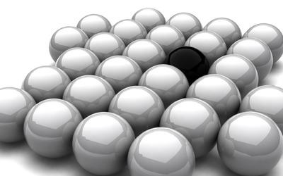 Black sphere among grey ones wallpaper