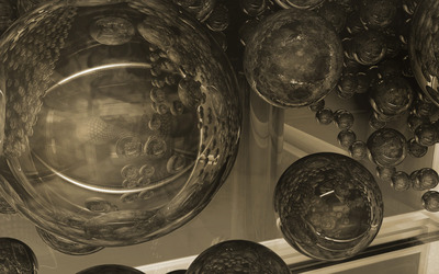 Glass spheres reflecting each other wallpaper
