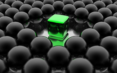 Green cube among black spheres wallpaper