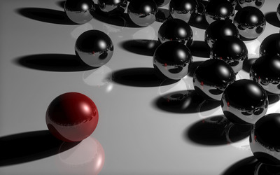 Red ball leading black metallic balls wallpaper
