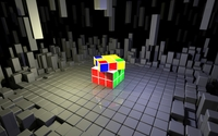 Rubik's Cube on top of gray cubes wallpaper 2560x1440 jpg