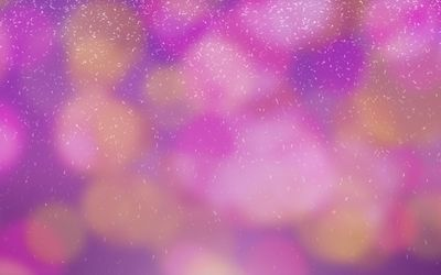 Colorful blurry lights behind the snowflakes wallpaper