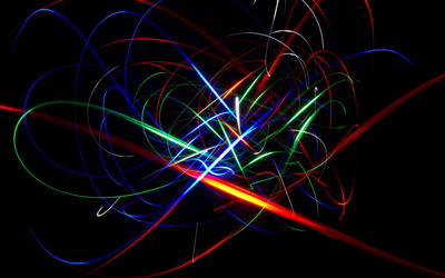 Colorful glowing curves dancing in the dark room Wallpaper