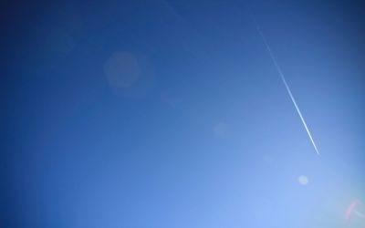Contrail on doted sky wallpaper
