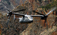 Bell Boeing V-22 Osprey flying between rocky peaks wallpaper 1920x1080 jpg