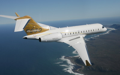 Bombardier Global Express above the ocean wallpaper