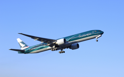 Cathay Pacific Boeing 777 in flight wallpaper