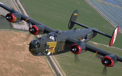 Consolidated B-24 Liberator flying above the fields wallpaper