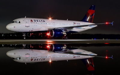 Delta Airbus A319 at night wallpaper