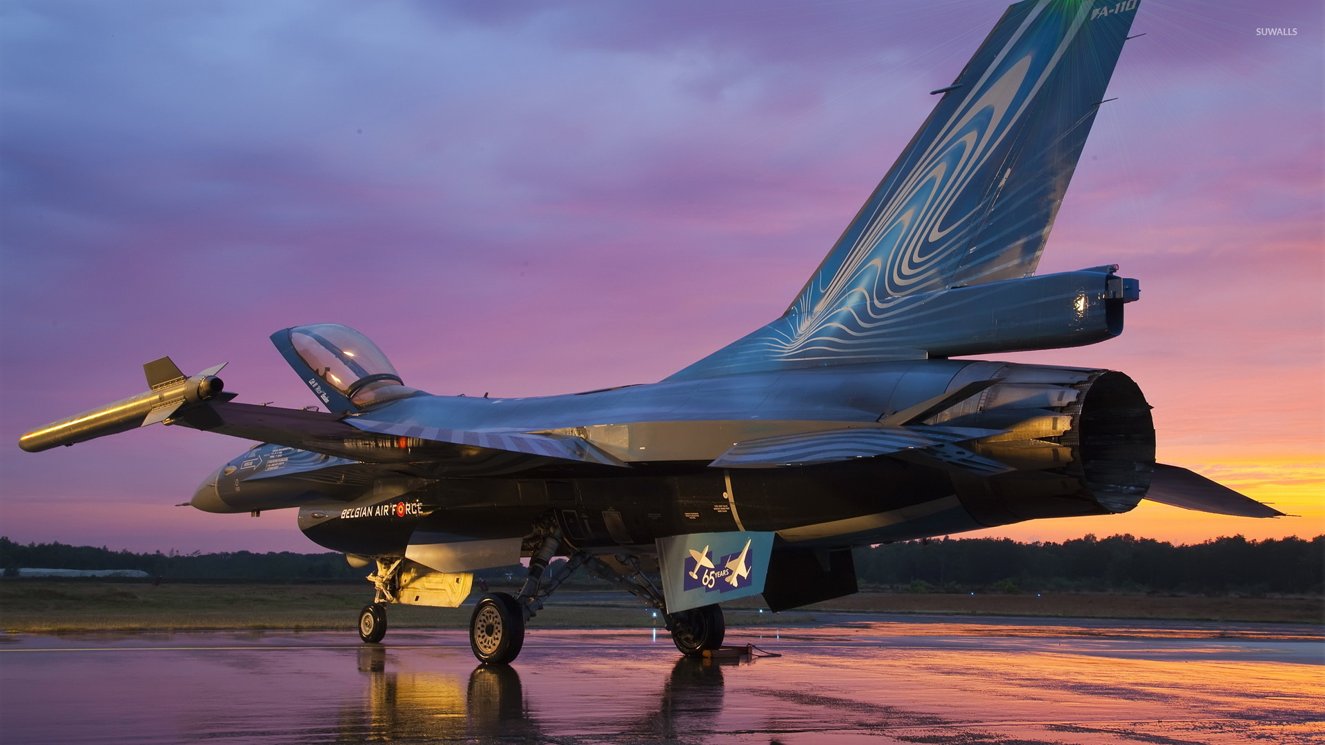 General Dynamics F-16 Fighting Falcon On Wet Airport Track