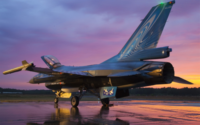 General Dynamics F-16 Fighting Falcon on wet airport track wallpaper