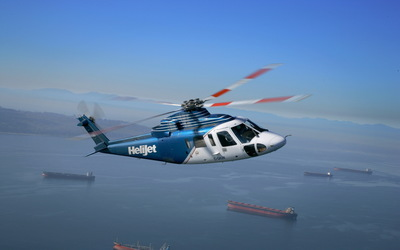 Helijet S76 flying over the cargo ships wallpaper