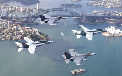 Jet Fighters flying over the city wallpaper