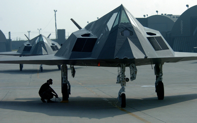 Lockheed F-117 Nighthawk on a military airport wallpaper