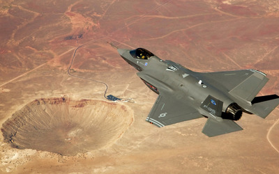 Lockheed Martin F-35 Lightning II above the crater wallpaper