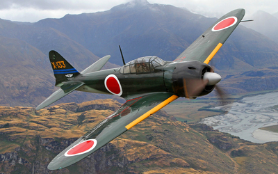 Mitsubishi A6M Zero flying above the hills Wallpaper