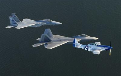 North American P-51 Mustangs flying over the ocean wallpaper