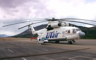 Small helicopter near a Mil Mi-26 wallpaper