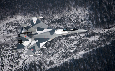 Sukhoi Su-35 above the snowy forest wallpaper