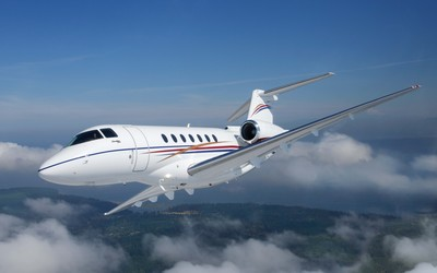 White business jet flying wallpaper