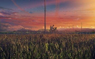 Young couple on a bike Wallpaper