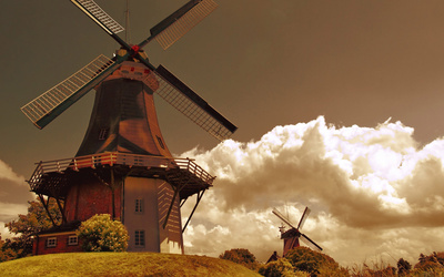 Fuzzy clouds over the windmills Wallpaper