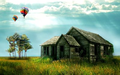 Hot air balloons above the ruined house Wallpaper