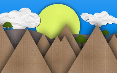 Sun and mountains made from cardboard wallpaper