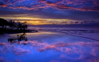 Amazing purple sunset clouds reflected in the wet beach wallpaper 1920x1200 jpg