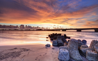 Amazing sunset clouds above the stone bridge wallpaper