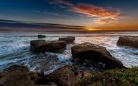 Beautiful ocean sunset above the rocky shore wallpaper 2560x1600 jpg