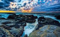 Blue and golden clouds over the foamy ocean wallpaper 3840x2160 jpg