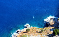 Blue ocean at the rocky shore wallpaper 2560x1600 jpg