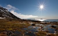 Bright sun high on the blue sky above the ocean wallpaper 2560x1600 jpg