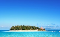 Clear sky over a resort on a Fiji island wallpaper 2560x1600 jpg