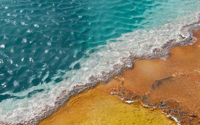 Colorful sand in the blue ocean wallpaper