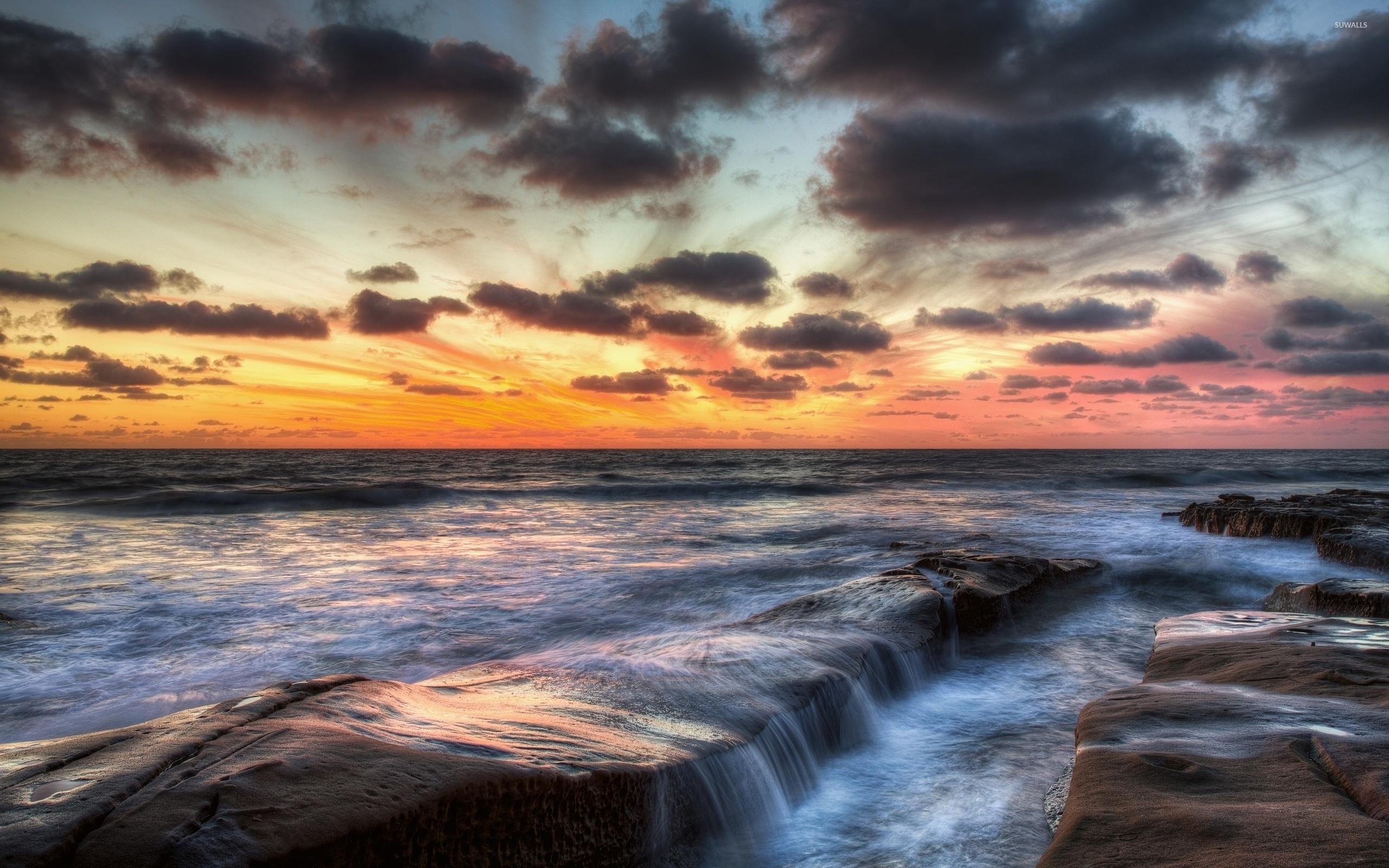 dark clouds over the ocean wallpaper beach wallpapers