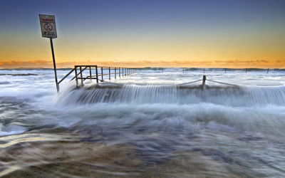 Flooded pier at sunset wallpaper