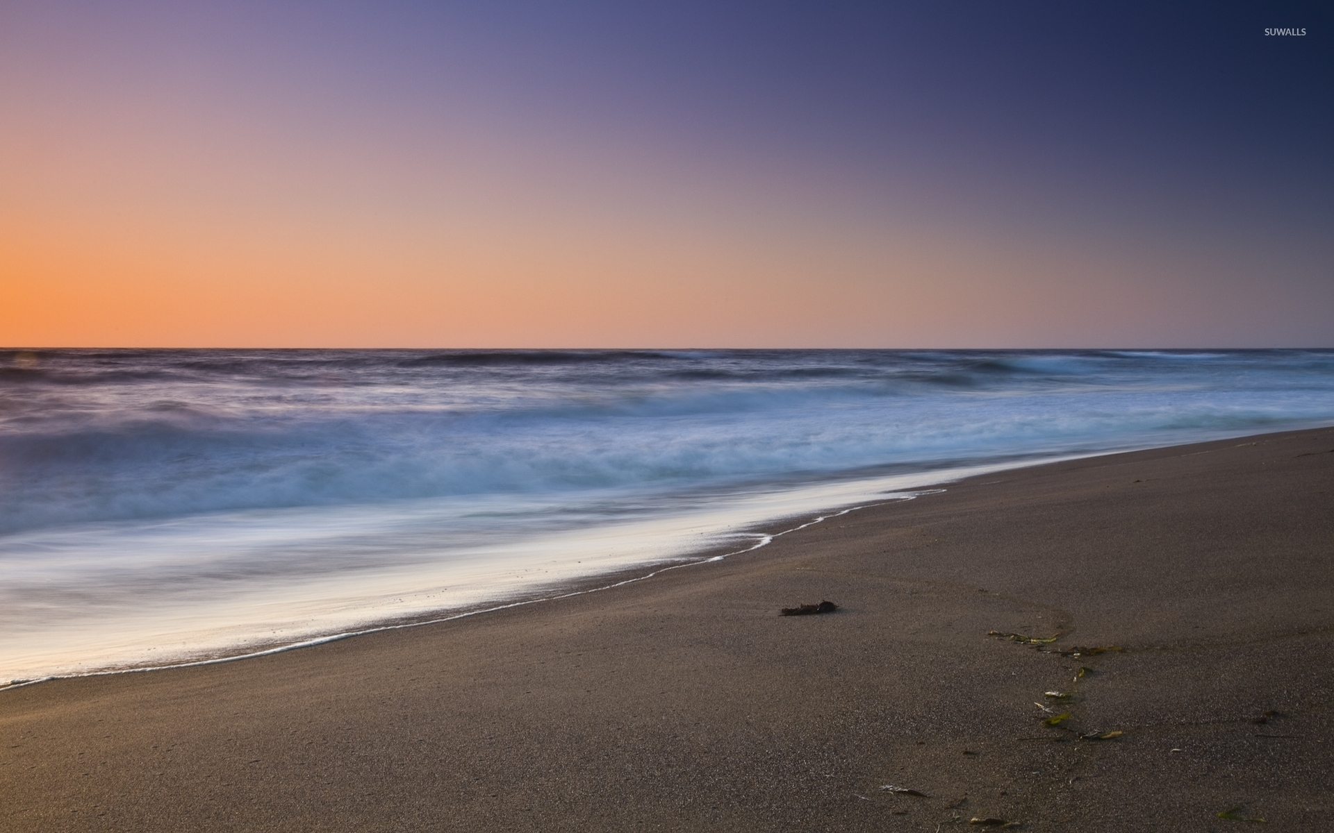Sandy Beach Wallpaper: Foamy Waves Approaching The Sandy Beach Wallpaper