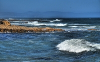 Foamy waves splashing on the rocky shore wallpaper 1920x1200 jpg