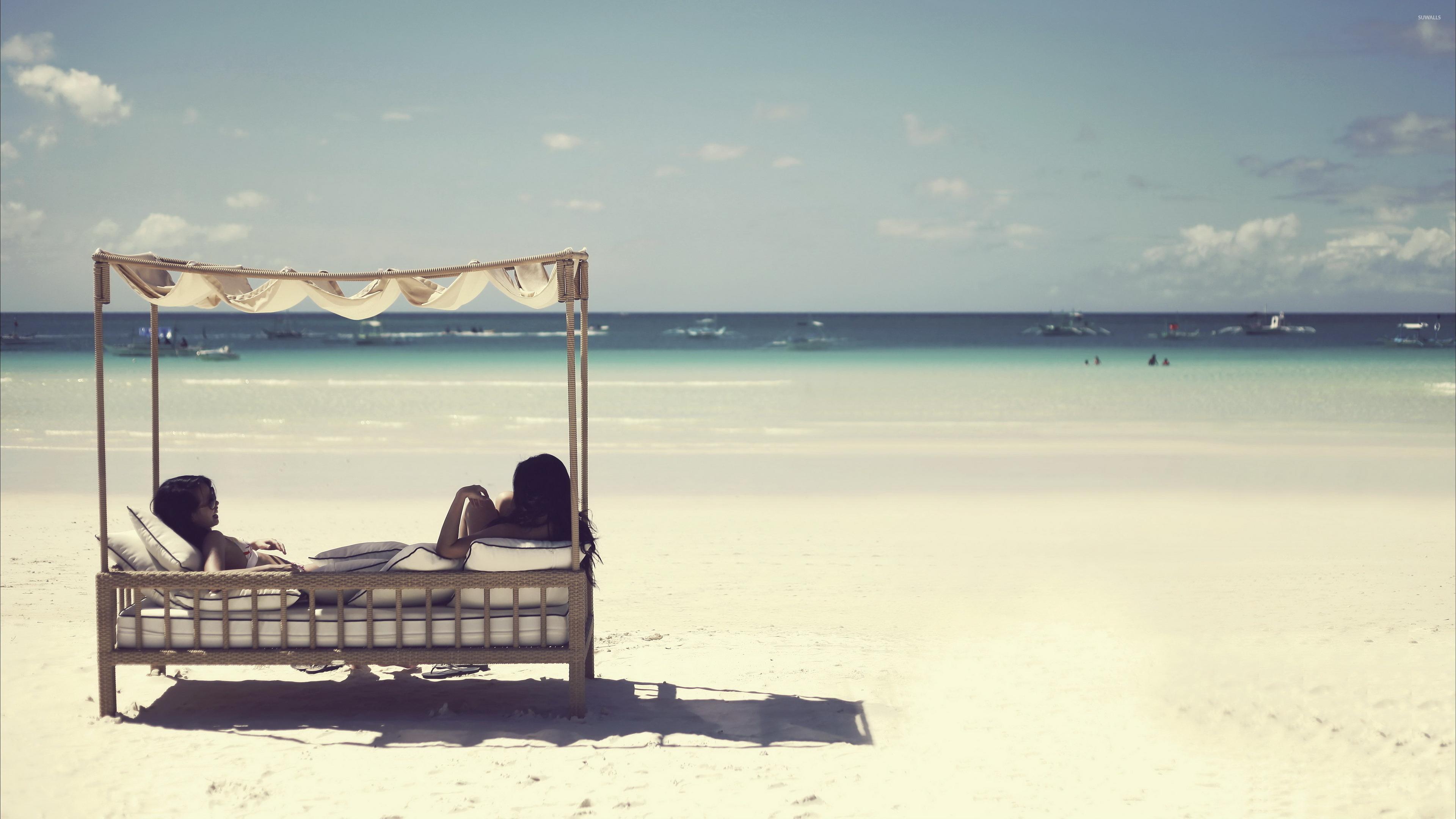 Girls Relaxing On A Sandy Beach Wallpaper Beach Wallpapers 40310