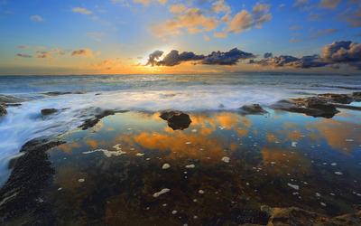 Golden clouds over the ocean wallpaper
