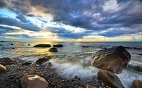 Golden sunset light reflected on the wet rocks on the beach wallpaper 2560x1600 jpg