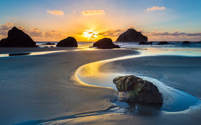 Golden sunset on a sandy beach wallpaper