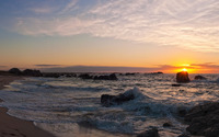 Golden sunset over the rocky beach wallpaper 2560x1440 jpg