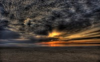 Golden sunset piercing through dark clouds wallpaper 2560x1600 jpg