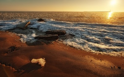 Icy waves on sandy beach wallpaper
