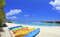 Kayaks on a tropical beach wallpaper 1920x1200 jpg
